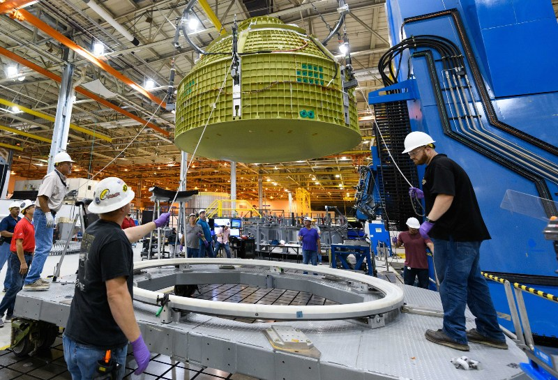 At the NASA Michoud Assembly Facility in Louisisana, Lockheed martin technicians have completed construction of the first Orion vapsule structure that will carry humans to deep space n Exploration Mission-2. Credit NASA